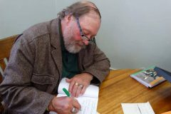 Signing-his-book-Irish-To