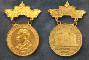 Image of two dedication medallions from the 1903 ceremony.